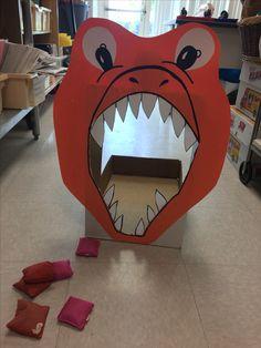 Dinosaur party games bean bag toss