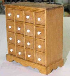 Apothecary chest. Would be great covered in coordinating papers or fabrics