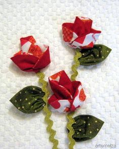 FABRIC ORIGAMI ROSES. Add dimension with roses you make out of faced circles that are folded and shaped to form roses. Leaves are dimensional as well.