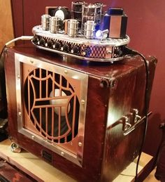 All-tube guitar amp made from 4-barrel muscle car air cleaner and 1940s Bell & Howell speaker cabinet.