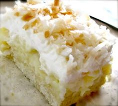 Coconut cream pie cookie squares!  Sugar cookie crust, coconut pie filling, homemade whipped cream topping  YUMMY