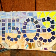 Would like to do this for our house number.  DIY Mosaic Glass Tile House Numbers