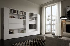 Una struttura in bianco e I frontati in laccato opaco caratterizzano questo modello GSG20 di mobili soggiorno senza maniglie. Compralo dai nostri negozi!