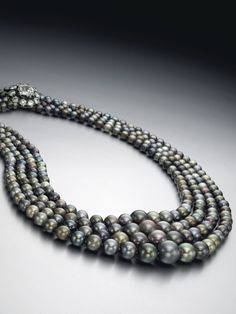 A four-strand natural colored pearl necklace measuring from 12.65 to 4.90 mm (est. $3.8 - 4.5 million)