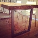 Reclaimed wood dining table with boxed steel legs.