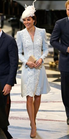 The stylish duchess was a vision in light blue and cream for a special service celebrating Queen Elizabeth's 90th birthday with the British royal family at St. Paul's. She wore a light blue Catherine Walker cream-embroidered coat dress and Jane Taylor hat accented by a cream fascinator studded with corsages.