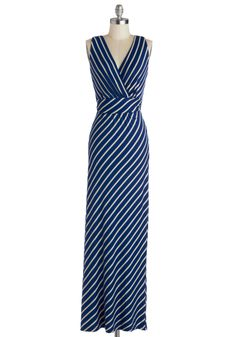 Be sure to fold this striped maxi dress into your embroidered weekender. Your first morning, toss a stack of books into a canvas tote, slip on your fuchsia patent sandals, and tie back the sash of this surplice V-neck frock for a full day of waterfront reading.