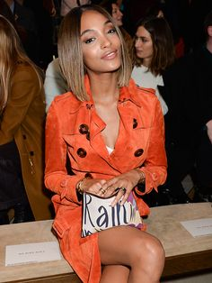 Star Tracks: Tuesday, January 13, 2015 | ORANGE YOU GLAD? | Burberry model Jourdan Dunn shows her support for the fashion label, sitting front-row at Monday's Burberry Prorsum menswear show in London.