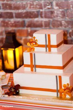 A modern orange and gray wedding cake.
