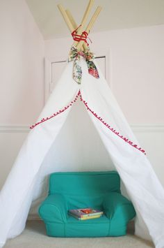 DIY tent in the nursery - just added pompom trim and floral fabric!