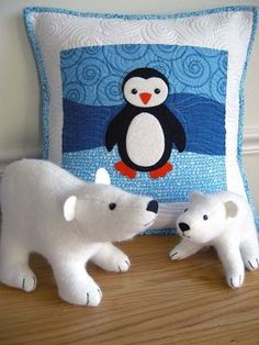 quilted white and blue baby penguin cushion