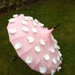 Pink Edwardian umbrella with white flowers