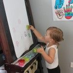 Brilliant ways to use a child's easel - cookie cutter printing