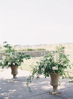 Jen Huang Carneros Inn Wedding Ceremony Design by Studio Mondine Large urn floral arrangement.