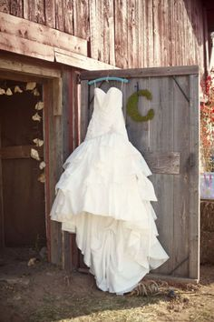 Love this idea!  Bridal gown displayed on a barn door...need to do this at The Carriage House Gardens @ Castleton Farms