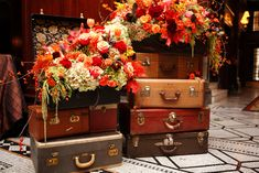 Fall Flowers in Vintage Suitcases. Would make a fabulous window display