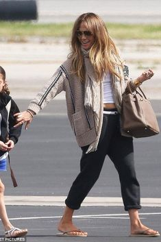 Jennifer Lopez wearing Brunello Cucinelli Beige Wool Blend Cardigan and Hermes Birkin 35 Bag