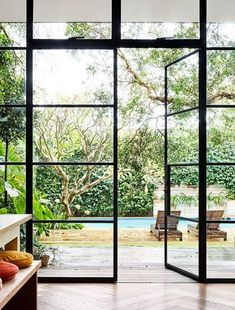 The brilliantly bold and cheerful renovated home of designer and artist Rachel Castle. Love the dark framed windows and the herringbone wood floors. Steel Windows, Huge Windows, Windows And Doors, Home Interior, Interior And Exterior, Interior Colors, Interior Ideas, Orangerie Extension, Sunshine Homes