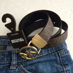 """MK reversible belt Authentic Michael Kors reversible adjustable belt. Adjustable 33.5"""" to 37.5"""". Dark brown synthetic leather with MK gold buckle. New, never used. Michael Kors Accessories Belts"""