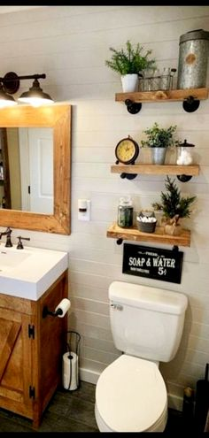 Unique bathroom floating shelves add to this small bathroom remodel for more storage space and farmhouse style decorating touch. Outhouse Bathroom Decor, Bath Decor, Bedroom Decor, Attic Bathroom, Bathroom Inspo, Bathroom Ideas, Country Farmhouse Decor, Farmhouse Style Decorating, Modern Interior Design