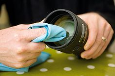 How to clean a camera lens. http://www.digitalcameraworld.com/2012/09/16/how-to-clean-a-camera-lens/