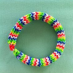 "Introducing FIESTA 7"", a Gorgeous 6 Point Hexafish Bracelet Using Blues, Greens, Red, Pink, Yellow, and White Rainbow Loom Bands.  A Beauty!..."