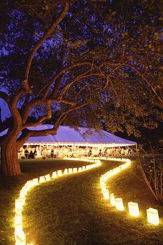 Whether you're using candles or lanterns, it's easy to get innovative with lighting: | 24 DIY Decorations That Will Make Any Wedding Look Like A Million Bucks Outdoor Wedding Lights, Light Wedding, Diy Wedding Marquee, Outdoor Weeding Ideas, Country Weeding Ideas, Wedding With Lights, Outdoor Wedding Ceremonies, Backyard Wedding Lighting, Outdoor Night Wedding