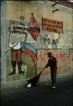 © Bruno Barbey/Magnum Photos PORTUGAL. Peniche, in the Estremadura region. Slogan against the rich painted on a wall. 1979.