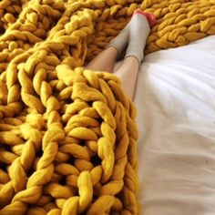 This wonderful Mustard colour chunky knit blanket is perfect for adding a splash of colour and texture to any room. Hand knit on giant knitting needles in my Loft Studio in Devon this blanket is a real talking point. The beautiful golden mustard colour is Giant Knit Blanket, Chunky Blanket, Chunky Knit Throw, Mustard Bedding, Yellow Bedding, Mustard Bedroom, Yellow Bedrooms, Sisal, Giant Knitting