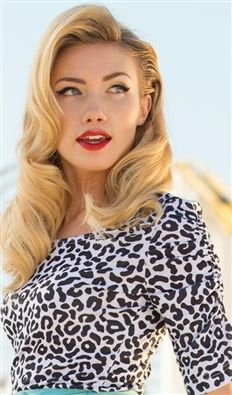 great look. can never go wrong with animal print, and a classic red lip, winged liner and vintage hair.