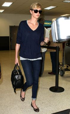 Charlize Theron pulls off the jet-lag look pretty darn well! Lovin' her loose sweater, skinnies, animal print flats and of course her oversized black shades!