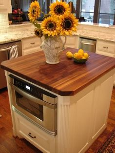 can put microwave in small island with rounded corners for small spaces - can also store cookbooks on open shelves and have a winerack in it too!