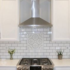 We could consider a single large accent tile as a focal point above the stone? These subway tiles are too small and too much grout Stove Backsplash, Grey Backsplash, Cement Tile Backsplash, Backsplash For White Cabinets, Cement Tiles, White Tile Backsplash Kitchen, Wallpaper Backsplash Kitchen, Black And White Backsplash, Decorative Tile Backsplash