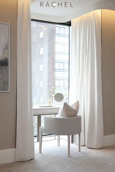 Window desk/vanity niche framed in light draperies for soft texture and drama.