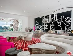In Gwen Stefani's sitting room, she boldly pairs hot pink with red, yet somehow makes it work.