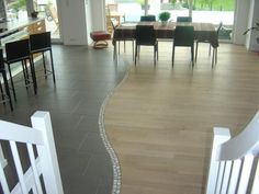 Great transition from tile to wood flooring.  Who ever said the transition had to be a straight line?