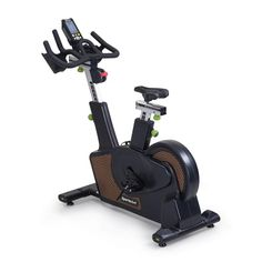 The C516 Status Indoor Cycling Bike from SportsArt Fitness is a upright exercise bike with full commercial warranty for group cycling class usage in any club or indoor cycling studio setting. It is the embodiment of design, technology, sustainability, and cardiovascular excellence. The C516 features a rear drive flywheel design with a self-powered, zero-friction magnetic braking system promoting energy saving benefits and a whisper quiet poly-v belt for smooth reliable operation. Indoor Cycling Bike, Cardio Equipment, Upright Exercise Bike, Sustainability, Commercial, Save Energy, Cycling Workout, Technology, Club