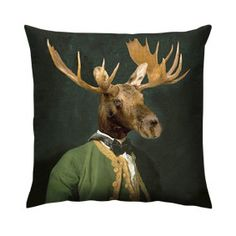 Lord Montague Cushion -This mighty Moose looks quite the gentleman in his green brocade edged coat.  Lord Montague evokes the atmosphere of a traditional mountain hunting lodge with a roaring fire, team him with a beaten up leather armchair and a dark green woollen throw to complete the look.