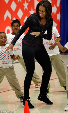 Moving: Michelle, pictured at a 2013 Let's Move event, has a documented history of encouraging other people to have fun while working out Black Girl Magic, Black Girls, Barak And Michelle Obama, Presidente Obama, Barack Obama Family, Michelle Obama Fashion, Friends Workout, Sexy Women, Black Presidents