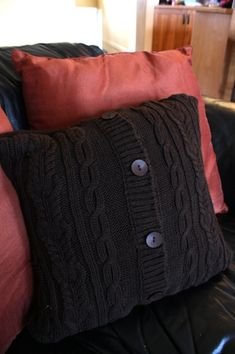 Sweater pillow cover:  Found a grey sweater just like this at Goodwill for less than $2, along with a little throw pillow.  Had to hand sew it because it was too thick for my sewing machine.  Even with that hiccup though, it was a quick project and looks great on my bed with my white throw pillows.  I want to do it again~
