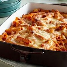 Creamy Baked Ziti 4 cups ziti pasta, uncooked 1 jar (26 oz.) marinara sauce 1 can (14-½ oz.) diced tomatoes, undrained 6 oz. (¾ of 8-oz. pkg.) PHILADELPHIA Cream Cheese, cubed ¾ cup BREAKSTONE'S or KNUDSEN Sour Cream 1 pkg. (8 oz.) KRAFT Shredded Mozzarella Cheese ⅓ cup KRAFT Grated Parmesan Cheese