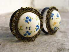 "Bluebell - Sizes 3/4 (19mm) to 1"" (25mm) romantic vintage plugs for stretched ears. £22.00, via Etsy."