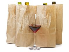 Taste Test: Is There Good Pinot Noir Under $15?  All of these wines are widely available for under $15 retail, and some under $10. We covered 12 bottles with brown bags and tasted them all blind, narrowing it down to five top picks for a second-round showdown.