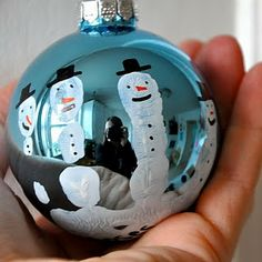 handprint snowman ornament. :) Madison made one of these for me a few christmas back!