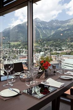 The aDLERS design hotel is a first-class hotspot for travelers and offers views over the city and mountains. Innsbruck, Design Hotel, Wander, Hotels, Skyline, Mountains, City, Beach, Places