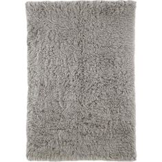 Add a touch of texture to your den or master suite with this lovely shag rug, artfully handcrafted from New Zealand wool in a neutral gray hue. ...