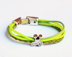 Neon tones of green bracelet with silver bike bead by pureshapes, $10.90