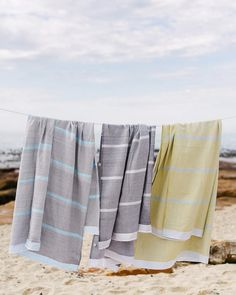 The Mungo Tawulo is a versatile bath, beach or pool towel. Woven from pure cotton in textured tones with a bold stripe detail. Woven at the Mungo Mill in SA Laundry Logo, Beach Fabric, Textures And Tones, Nature Beach, Weaving Process, Pool Towels, Bold Stripes, West Africa, Beach Day