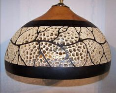 Filigree Hanging Shade   by Karen Hundt-Brown  This large gourd features an open band of filigree work done around a wandering vine. The cut and carved areas are boarded by two Black band of acrylic paint and the underside of the shade is gilt in 24k Gold leaf and sealed for years of protection.   Price: $300.00  On Artful Vision, www.artfulvision.com a portion of your purchase is donated to a participating non-profit of your choice. #art #gift #home #decor #gourd #shade #Filigree #carving