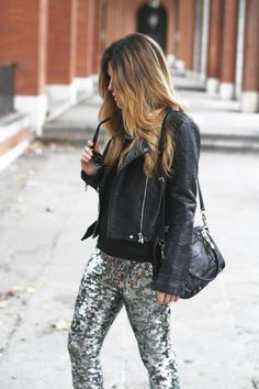 Daytime shimmer: sequin pants dressed down by pairing w/ a basic black sweater & leather jacket #StreetStyle